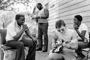 Larry Krizan plays guitar with some 3rd Ward locals in an impromptu jam session - 1986