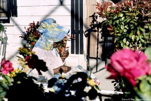 Mrs. Manue -Gaines quilting outside her home - 1987