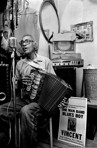 Vincent Frank playing accordion inside his home - 1986